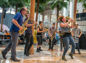Bang On A Can Marathon at the Winter Garden at Brookfield Place on June 21, 2015.Performers in order:Crossfire Steel Orchestra, Inc.Vicky Chow, piano, performing: Tristan Perich, Surface Image - for solo piano and 40-channel 1-bit electronicsDither (guitar quartet) performing:Lainie Fefferman, Tongue of Thorns- Florent Ghys, bassLJ White, Wilder Shores (world premiere - with original poetry by Matthew Dickman and Michael Dickman)- Third Angle New MusicGrand Band (6 pianos) performing: David Lang, face so paleAsphalt Orchestra Performing:  Pixies / Charles Thompson, Bone Machine (arr. Peter Hess); River Euphrates (arr. Stephanie Richards); Cactus (arr. Ed RosenBerg III)Crossfire Steel Orchestra, Inc.Performing: Kendall Williams, Rehearsals, MisConceptionBang on a Can All-StarsPerforming: Julia Wolfe, Reeling (from Field Recordings)Johann Johannsson, Hz (from Field Recordings)Anna Clyne, A Wonderful Day (from Field Recordings)Todd Reynolds, Seven Sundays (from Field Recordings)Tomoko Mukaiyama, pianoperforming:   Somei Satoh, IncarnationsThird Angle New Music: Performing:   Julian Day, Quartz (NY premiere)Asphalt OrchestraPerforming: Ivo Papasov, Ivo's Ruchenitsa, Trakia Suite, Ilikovo Horo (arr. Peter Hess - world premiere of arrangement)Grand BandPerforming:  Paul Kerekes, wither and bloomSo Percussion & Nels Cline, guitar & Bobby Previte, drumsGrand Band: Performing:   Michael Gordon, Ode to La Bruja, Hanon, Czerny, Van Cliburn and little gold stars... (or, To Everyone Who Made My Life Miserable, Thank You.)Cyro Baptista, Forró for All- Cyro Baptista & FriendsGong Linna, voice & Bang on a Can All-StarsPerforming: Lao Luo, Michael Gordon, David Lang, Julia Wolfe, Cloud-River-Mountain (world premiere commissioned by Maria and Robert A Skirnick and Arts Brookfield)Glenn Branca EnsemblePhoto Credit: ©Stephanie Berger.